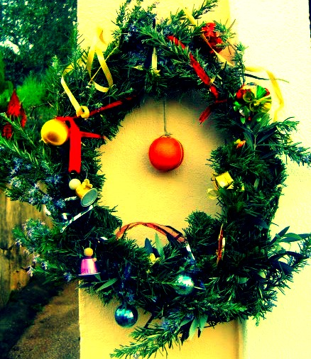 The Christmas wreath at our door this year. Yes, that is a real orange in the centre.