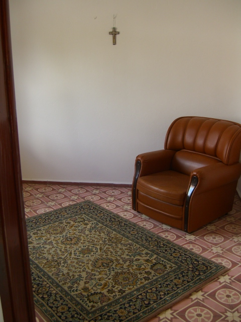 Chair and contrasting carpet and tiles.