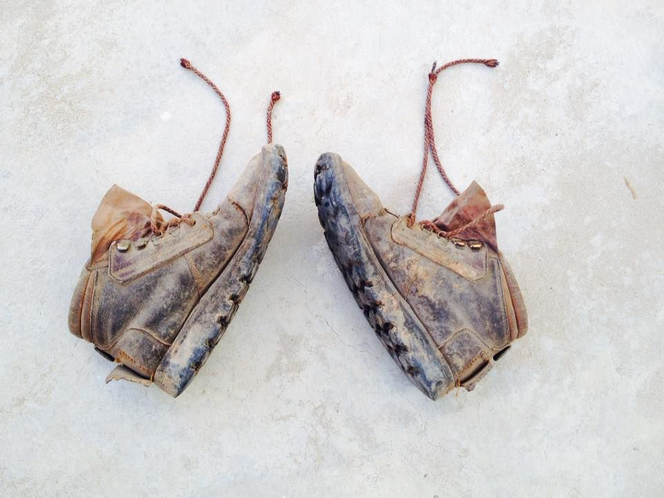 My Courtney boots from Zimbabwe, now ten years old, two of which have been spent as gardening boots. I dropped them on the concrete after gardening one day, and this is how they landed.