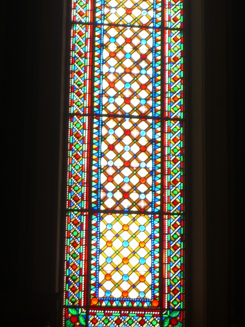 Stained glass window Glary stained glass window in the Sala d'Actes, El Seminari. Lucky pot shot by Allison.